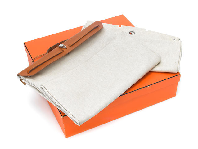 HERMES: A tan leather and canvas 'HERBAG' leather impressed HERMES PARIS,