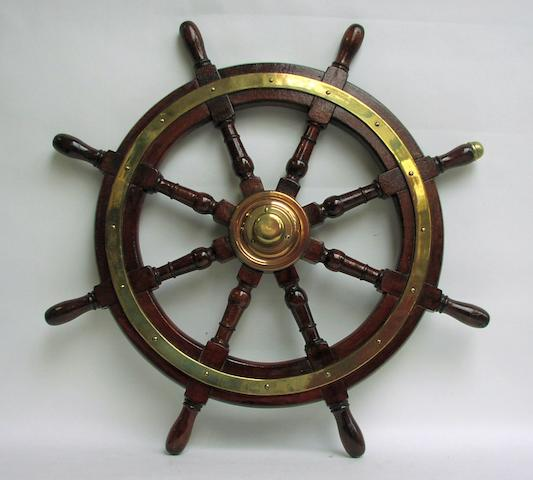 A mahogany and brass ships wheel, circa 1880 from a P&O ship.  36ins. (92cm)diam.
