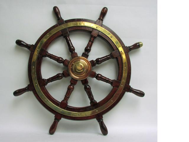 A mahogany and brass ships wheel, circa 1880 from a P&O ship.  36ins. (92cm)diam.