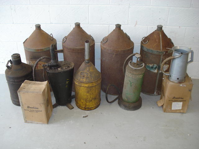 Assorted fuel cans and garage equipment,