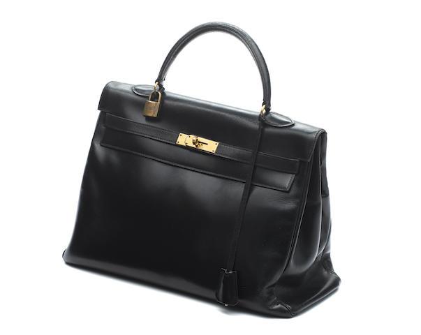 """HERMÈS: A black leather 'Kelly' bag, backstamp """"R"""", 1962,"""