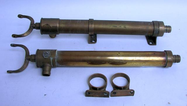 A pair of bronze single action bilge pumps, 23ins. (58cm)long, each. 2