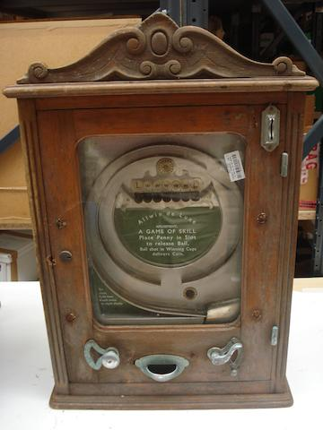 An Allwin de Luxe wall machine,