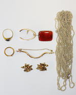 A small collection of jewellery Including a very long seed pearl ropetwist necklace, a 19th century cornelian brooch, two Victorian gem set scarf clips, a small signet ring, a pair of gold earclips modelled as roses and a cased childs three row coral bead necklace.