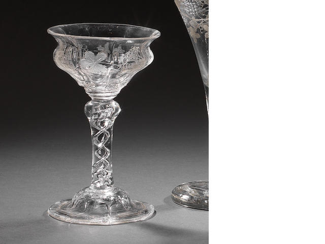 An engraved airtwist sweetmeat or champagne glass