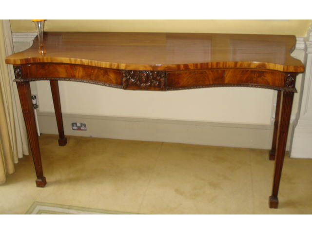 A mahogany serpentine fronted two drawer serving table