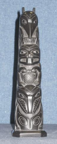A Northwest Coast argillite model totem pole 20.8cm high