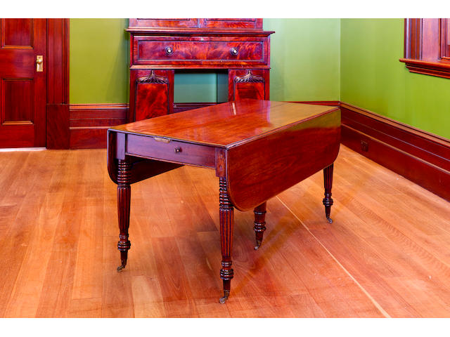 A rare Australian cedar Pembroke extension dining table with three extra leaves circa 1830