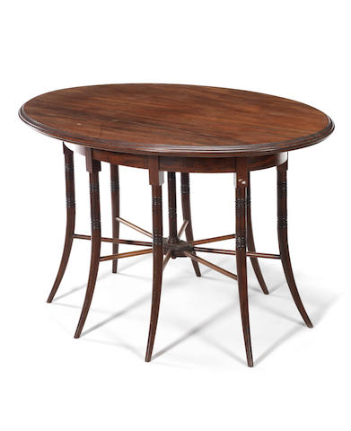 An oval mahogany centre type table in the style of E. W. Godwin