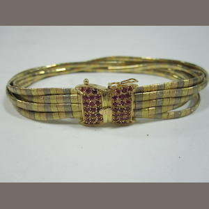 An 18ct tri colour gold bracelet with ruby set clasp