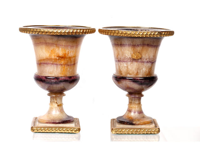 A pair of 19th Century Derbyshire blue john and gilt metal mounted urns