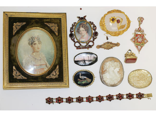 A collection of jewellery,including a garnet framed miniature, a garnet bracelet, an agate & garnet brooch, a silver mounted cameo, a Cantonese mother of pearl brooch, a silver & enamel brooch, a micro-mosaic pendant, a 19th century fob seal, a 19th century easle framed portrait miniature, etc.