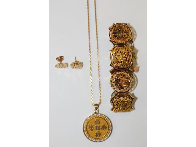 A Vietnamese gold bracelet, pendant and earrings