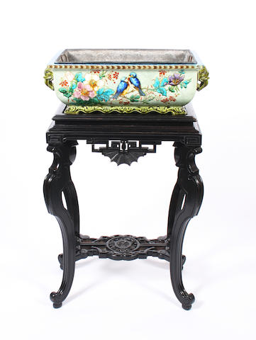 A glazed earthenware jardiniere by Theodore Deck and ebonised stand