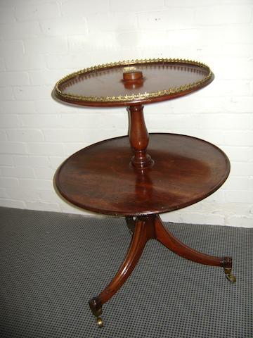 A George III mahogany two tier dumb waiter with circular dished tiers and tripod support, 66cm diameter, 91cm high