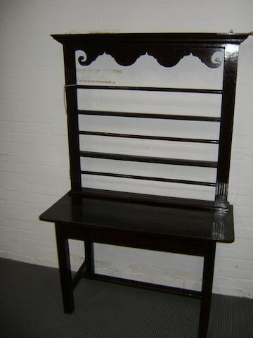 An oak dresser, the plain stand with H-shaped stretcher, three tier plate rack, 114cm wide, 176cm high