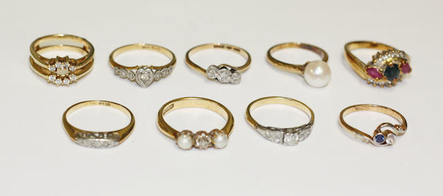 A collection of nine gemset rings.