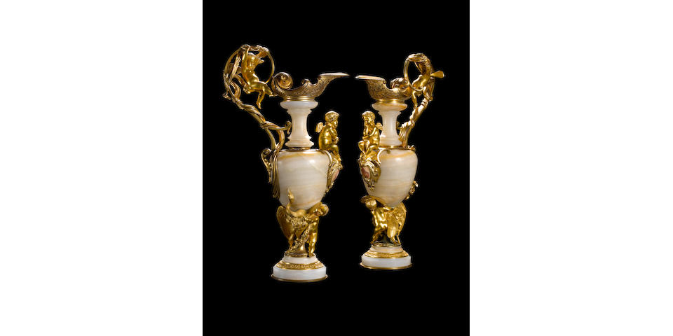A pair of French mid-19th century gilt-bronze and onyx ewersby Compagnie des marbres Onyx d'Algerie, the model exhibited at the 1862 International Exhibition, London