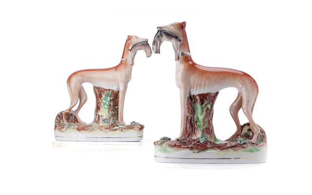 A pair of Staffordshire greyhounds 19th century
