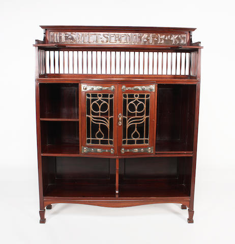 A mahogany bookcase by Shapland & Petter, Barnstaple