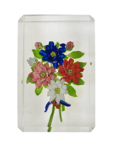 A Russian faceted floral bouquet paperweight plaque, early 20th century