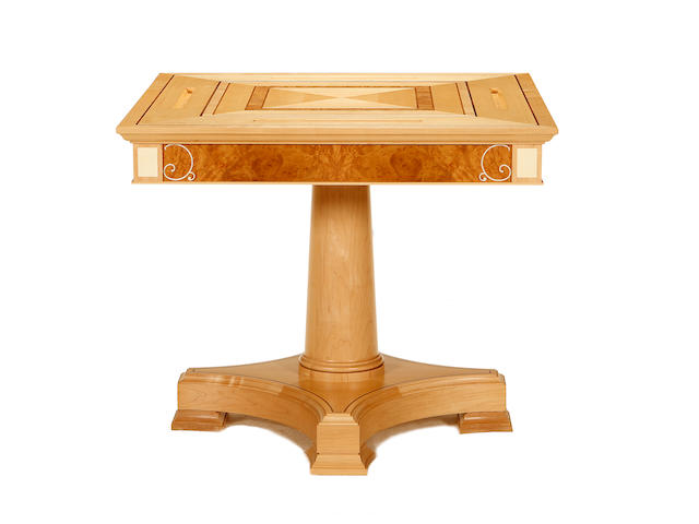 A Linley maple and burr walnut games table