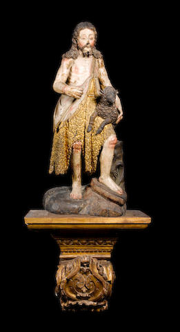 A Spanish late 17th / early 18th century carved wood, parcel gilt and polychrome decorated figure of Saint John the Baptist