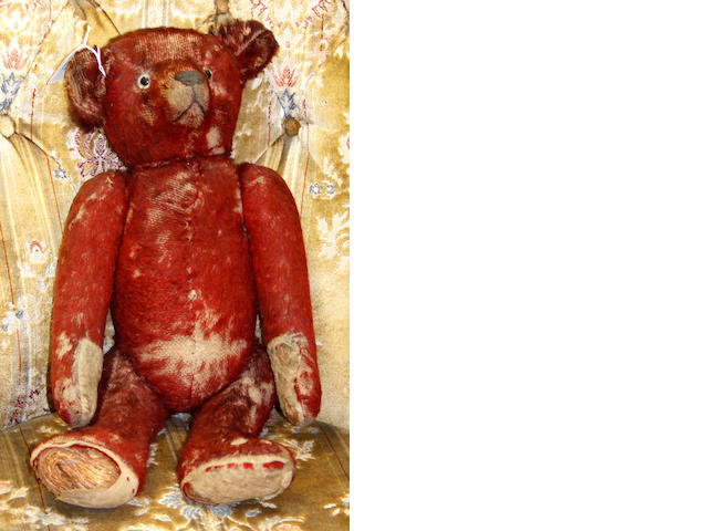 A rare red plush teddy bear, probably English, Chad Valley, with straw stuffed body, 50cm.