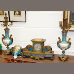 A 19th century French Rococo style gilt metal and Sevres style porcelain matched three piece clock garniture
