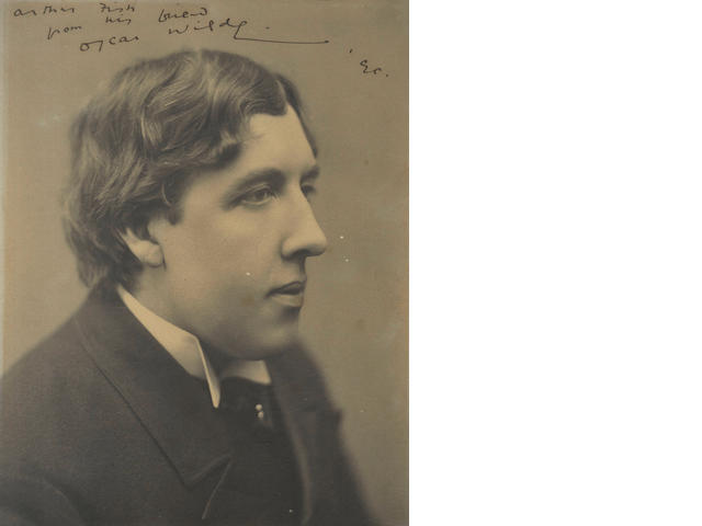 WILDE (OSCAR) Photograph of Wilde, signed and inscribed, 1890