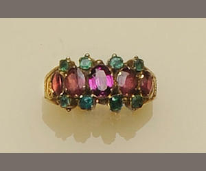 A garnet and emerald ring
