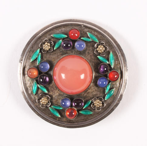 An Arts and Crafts multi gem-set brooch attributed to Edith Linnell With engraved flower motif to the reverse,