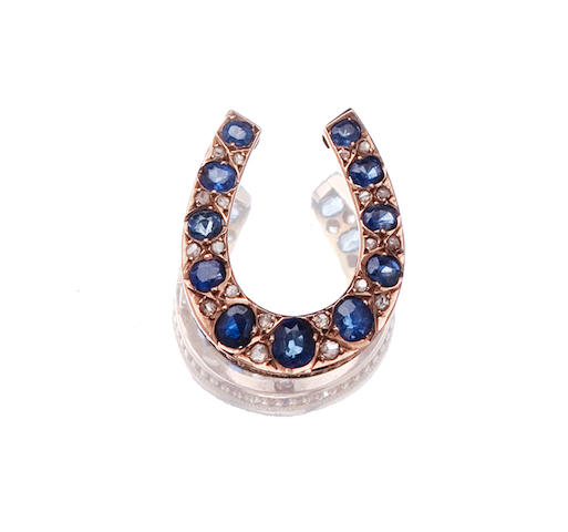 A sapphire and diamond horseshoe brooch