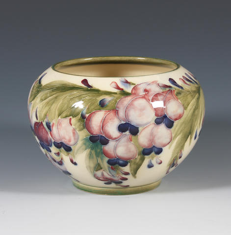 A Macintyre 'Wisteria' vase designed by William Moorcroft