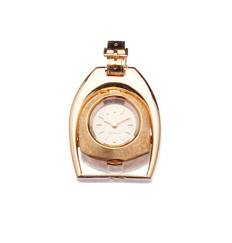 A lady's pendant watch in the form of a stirrup, by Cartier