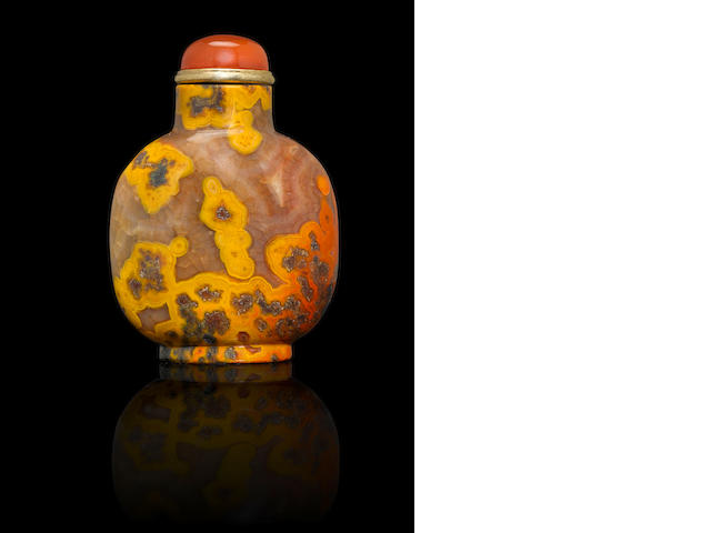 An agate 'orange-splash' snuff bottle Mid Qing dynasty