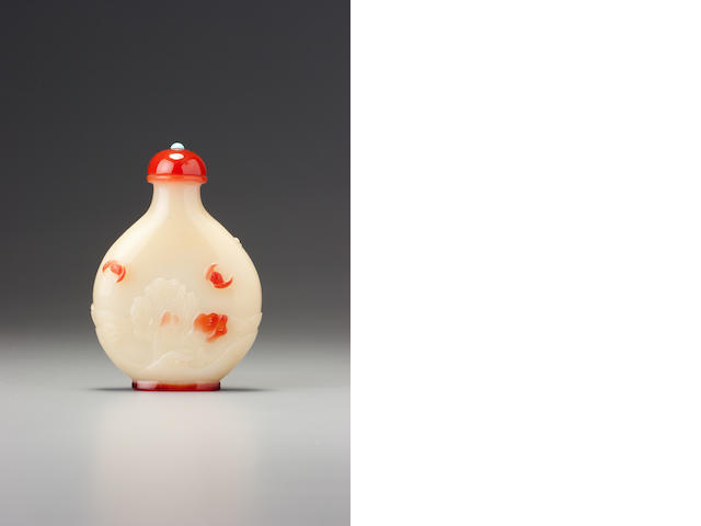 A ruby-red and greenish-beige glass 'crane and bats' snuff bottle Yangzhou, 1830-1890
