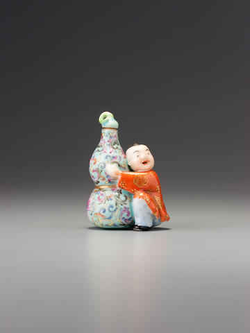 A moulded 'famille-rose' porcelain 'boy and double gourd' snuff bottle Jingdezhen, Qianlong iron-red six-character seal mark, 1870-1930