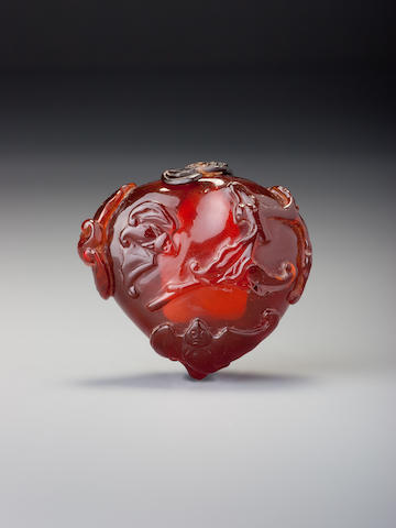 A carved amber 'bats and peach' snuff bottle 1740-1820
