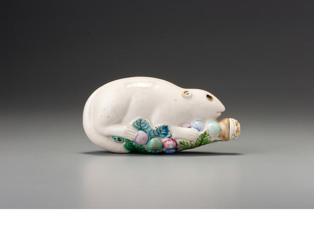 A moulded 'famille-rose' porcelain 'squirrel' snuff bottle Jingdezhen, 1790-1830
