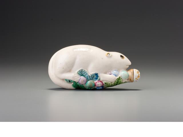 A moulded 'famille-rose' porcelain 'squirrel' snuff bottle Jingdezhen, 1790-1830