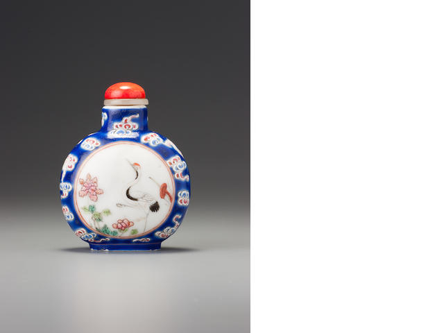 A 'famille-rose' porcelain 'cranes' snuff bottle Imperial kilns, Jingdezhen, Daoguang iron-red four-character seal mark and of the period, 1821-1840
