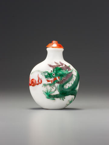A moulded 'famille-rose' porcelain 'dragon' snuff bottle Imperial kilns, Jingdezhen, Daoguang iron-red four-character seal mark and of the period, 1821-1850