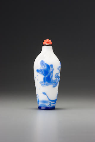 An inscribed sapphire-blue glass overlay 'luohan' snuff bottle Yangzhou, 1870-1890
