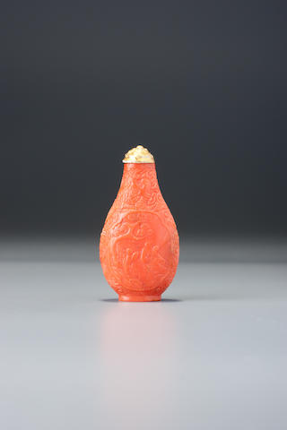A carved coral 'landscape' snuff bottle Possibly Imperial, 1700-1770