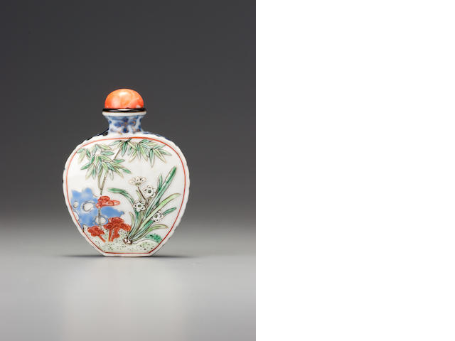A moulded 'famille-rose' porcelain 'garden scene' snuff bottle Imperial kilns, Jingdezhen, Qianlong iron-red four-character seal mark and of the period, 1770-1795