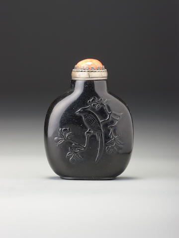 An inscribed jet 'bird and camellia' snuff bottle Yizhai, 1740-1880