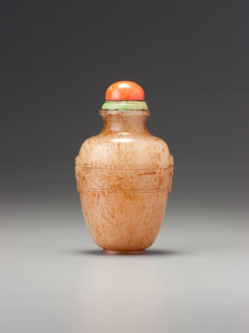 A nephrite  'archaistic motif' snuff bottle Probably Imperial, attributable to the palace workshops, Beijing, 1730-1780
