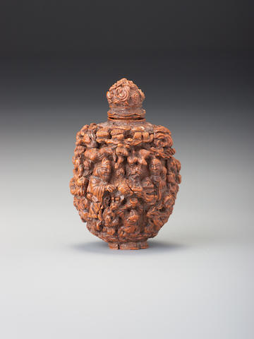 A carved peach stone 'Eight Immortals and God of Longevity ' snuff bottle 1760-1860