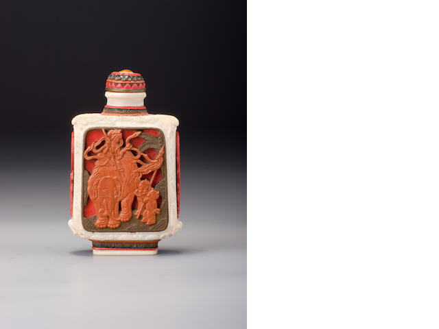 An ivory and lacquer 'elephant and dragon' snuff bottle School of the Imperial Master, Japan, 1854–1910